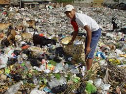 poor man searching in waste